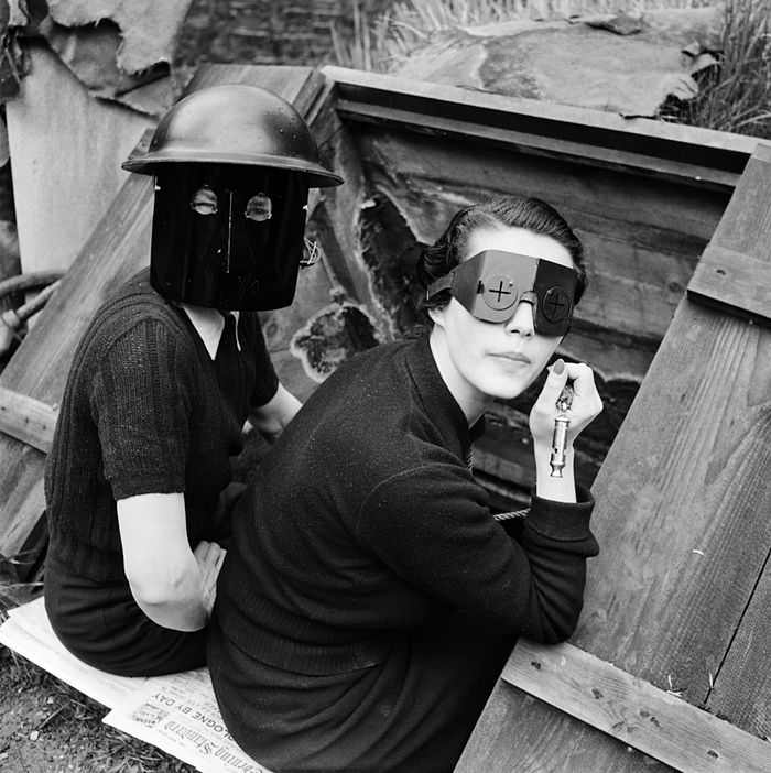Women in fire masks, Downshire Hill, Hampstead, London, 1941. Photo by Lee Miller.
