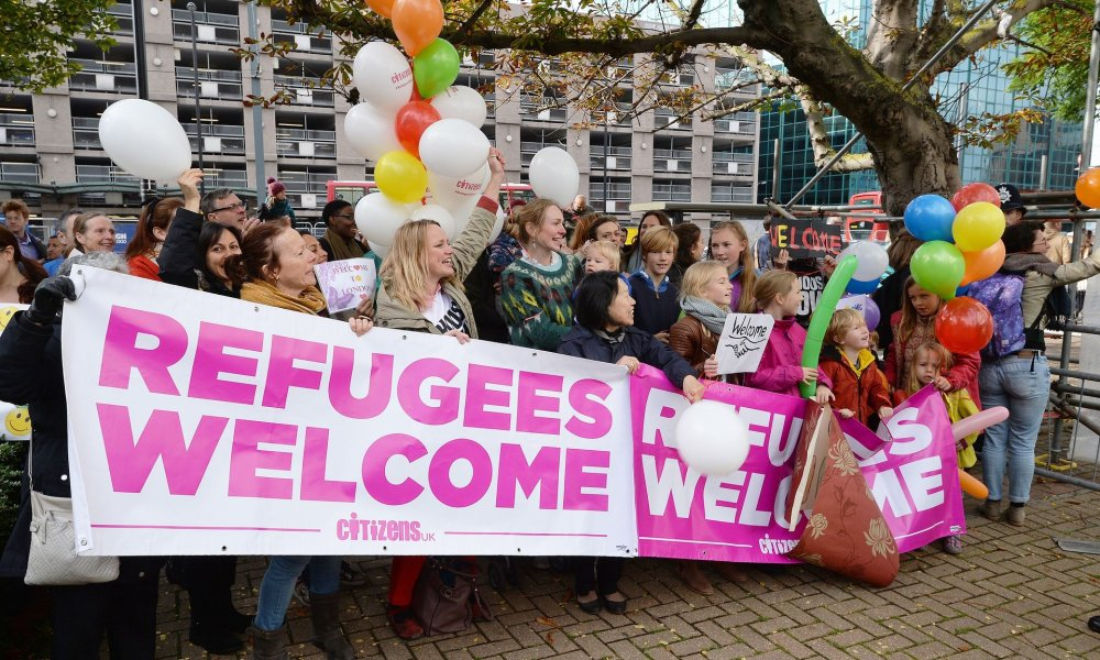 Members of the campaign group Citizens UK hold a 'refugees welcome' event outside Lunar House in Croydon. Photograph: John Stillwell/PA