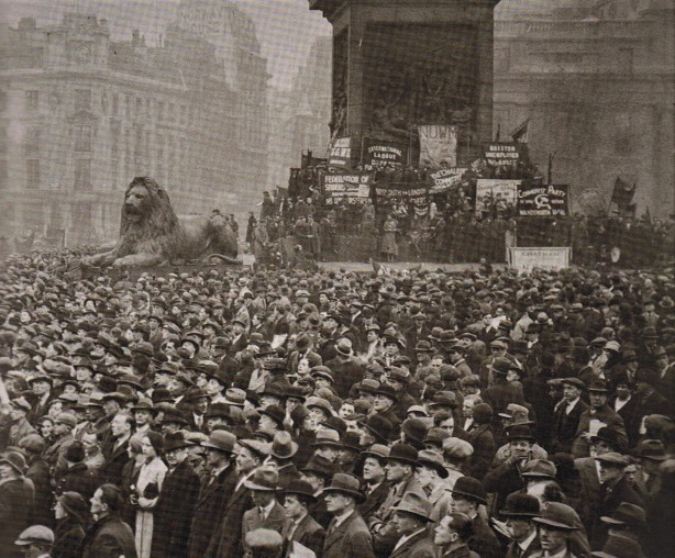 The picture of Trafalgar Square shows all heads turned as as section of the audience see the approach of the marchers.